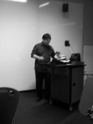 Our classmate, preparing for his presentation.